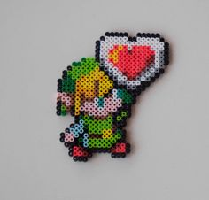 The Legend of Zelda link with heart  perler bead creation....melted beads with magnet on back. $6.50, via Etsy.