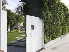 White Gated Exterior With Greens + Selma Blair's Former Home