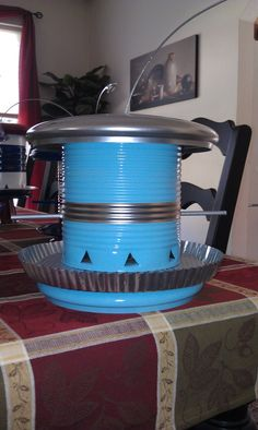 Recycled pot lids and coffee cans ~ What an awesome bird feeder!