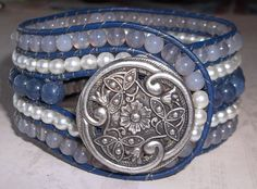 Check out this item in my Etsy shop https://www.etsy.com/listing/257676490/blue-glass-and-pearl-beaded-leather-cuff