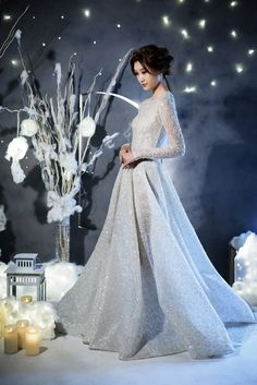 Snow maiden bride in a long sleeved snowflake-sprinkled Paolo Sebastian wedding gown and mystical sultry bridal hair and makeup // Winter's Night Wedding Inspiration with 3 Paolo Sebastian Gowns {Facebook and Instagram: The Wedding Scoop}