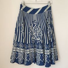 Anthropologie Blue and White Linen Skirt Anthropologie blue and white linen midi skirt by Maple. Fully lined and very swingy. Zips on side. In excellent condition! Anthropologie Skirts