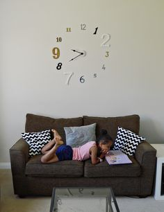 How to make a frameless wall clock. I like this better than the enormous clocks that are everywhere. We need some way to tell time from the living room besides squinting into the kitchen to see the oven clock.
