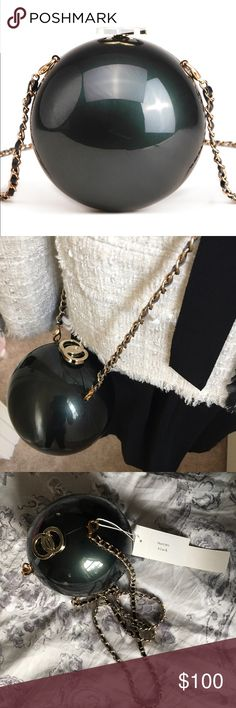 """Black Pearl Crossbody Clutch """"Different is divine in this sheeny pearl silhouette which features silver circular lock closure, soft velvet lining, and detachable braided gold link shoulder strap for added utility.""""                                                              Velvet lining. Detachable chain shoulder strap. Gold tone hardware details. 5.75"""" x 5.75"""" x 5.75"""".         Material: acrylic.        Price firm! Pink Haley Bags Crossbody Bags"""