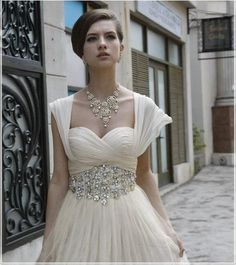 love this neckline! both the necklace and belt are a little much for me though.