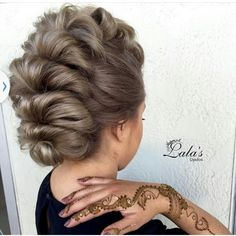Love this Mohawk styled up do