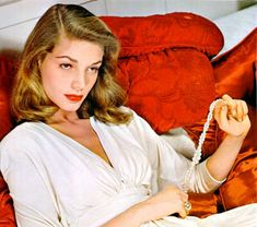 It's all in the eyebrow action...and the dress (Lauren Bacall)