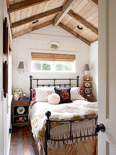 Love the bed... This petite bedroom overflows with character and charm! http://www.bhg.com/decorating/decorating-photos/bedroom/charming-space/?socsrc=bhgpin021115charmingspace&bedroom