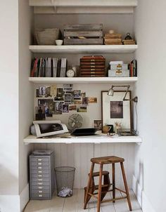 Workspace cubby. Mounted shelves, small filing cabinet, baskets and old crates for organizing.