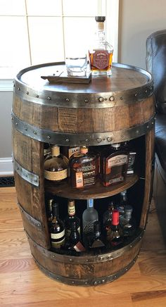 man cave basement Handcrafted Whiskey / Bourbon Barrel Cabinet, made from an authentic oak Whiskey barrel. Because these cabinets are crafted using actual used Whiskey barrels, there Used Whiskey Barrels, Wine Barrels, Wine Barrel Bar, Wine Cellar, Barrel Table, Whiskey Bottle, Home Bar Designs, Diy Casa, Man Cave Home Bar