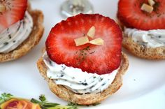 Top your bread with a homemade cream cheese and herb spread. Then add the star of the dish: a fresh and juicy strawberry in these mini tea sandwiches.