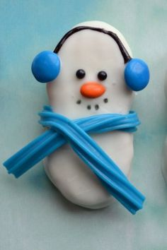 Nutter Butter coated with white chocolate. Tic tack nose and M&M ear muffs and licorice scarf. -cute