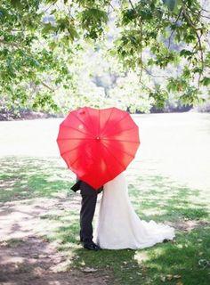 Grab a charming prop like this heart-shaped umbrella for wedding photo fun!   Christina Choi Photography