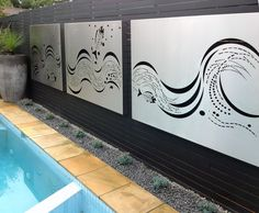 stainless steel wall art panels by the pool, by Entanglements, designed by Paal Grant Landscaping http://www.entanglements.com.au/shop/product/item172101/fish-wave-set-of-2-panels.html