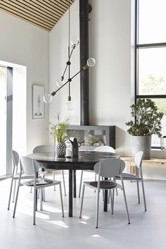 round black table, high ceiling living dining room ,simple scandinavian style [via House Doctor ] Dining Room Design, Dining Area, Dining Table, Table Lamp, Dining Room Inspiration, Interior Inspiration, House Doctor Lampe, Doctor House, Bamboo Curtains