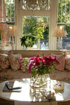 Flowers, sofa, table and window in the sunligth...pure serenity