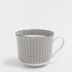 Imagen del producto Taza desayuno porcelana rayada bicolor