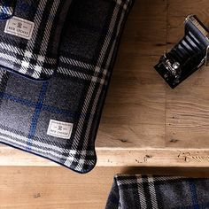 Ambassador Pillow case is crafted in a plaid and finished with navy blue trim. It comes with a fluffy and springy pillow insert.