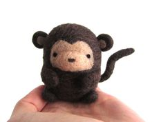 ~Made to Order~ This adorable needle felted monkey is handmade with love out of 100% natural wool. A pipe cleaner was used in the tail to maintain its shape. This monkey would make a great gift or decorative item to spruce up your desk or living space. Measurements are approximately: 9 cm (3.5) wide including tail 7 cm (2.75) high If you would like this item turned into a hanging ornament, please choose the With hanging loop option at checkout. As this item is made to order, it may vary...