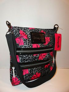 My Betsey Johnson cross-body bag! I very rarely change purses since I purchased this. It's my favorite! <3 (You can't tell from the picture, because they have them tissue wrapped, but the zippers are little lightning bolts. LOVE.)