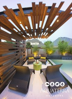 Modern Industrial seating area with a custom steel and wooden shade structure.