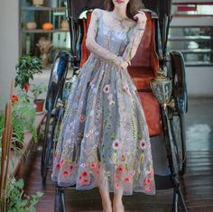 Design: Round Neck Long Sleeves Gathers Zip-back Fastening Needle and Thread Floral Embroidered Organza About me: Shell: Polyester Hand Wash Occasion Dress