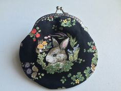 A personal favourite from my Etsy shop https://www.etsy.com/hk-en/listing/456104384/handmade-coin-purse-little-bunny-in-the