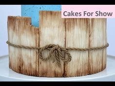 I made these fondant panels that look like aged wood to decorate a cake. The fondant will stiffen enough to hold shape, but not too much that it will crack w. Cake Decorating Piping, Creative Cake Decorating, Cake Icing Tips, Buttercream Cake, Bow Cakes, Fondant Cakes, Cake Fondant, Fondant Figures Tutorial, Cake Tutorial