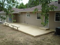 Here's a rectangular ground level deck with bench seats.