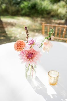 Bottle of autumn flowers for cocktail tables. Grown and designed by Love 'n Fresh Flowers.  Photo by Maria Mack Photography.