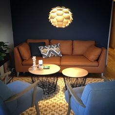 Livingroom details. Jotun Nordisk hav om the wall. Ikea Stockholm sofa, Ferm living baskets as coffetable....and THE lamp