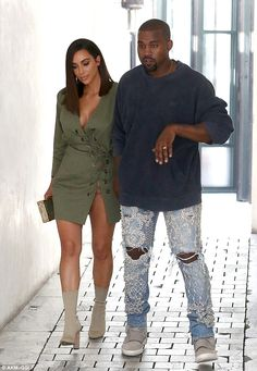 Short and sleek: Kim Kardashian showed off her new hairstyle on Sunday when she stepped out for lunch in Los Angeles with husband Kanye West