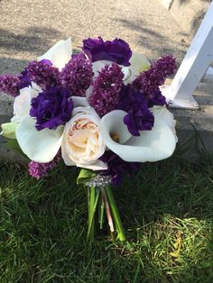 Dark purples, whites, and ivory bridal bouquet with white calla lily