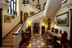 Plush: The seven bedroom property features a 16th century tower and a Victorian main house. Pictured is the main staircase