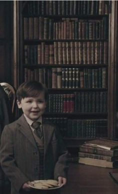 "Rory Burns as young Roger Wakefield MacKenzie Wakefield in 1946. ""May I have a biscuit, please?"" Roger is the adopted son of the Reverend Reginald Wakefield. His birth parents were killed during World War II; his father's plane went down and his mother was killed in the London Blitz. 