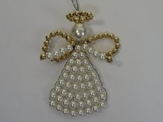 Vintage Handmade Pearl Angel Christmas Ornament, 121  Love the addition of arms on this beaded angel.