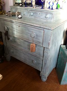 Antique dresser lightly painted with one coat ASP duck egg chalk paint.  Hand distressed and wax finish.