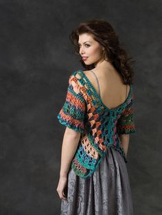 Viewing this from the back you can see why we named it Butterfly Wrap. This flattering shape is crocheted with two shades of soft wool blend yarn in colors as beautiful as those found in Nature.