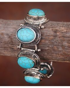 Must have turquoise link bracelet with toggle closure. High end look for just the right price! With West And Co. Jewelry, you get a chic, great quality and fun to wear piece every time-- all at just the right price! What more can a girl ask for?