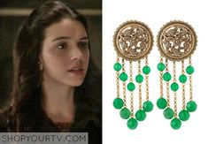 Mary Queen of Scots (Adelaide Kane) wears these floral-engraved bronze earrings with multi-strand, faceted green briolettes in this week's episode of Reign. They are the Stephen Dweck Medallion Green-Bead Earrings.  Buy them HERE for $300. All outfits from Reign Other Outfits … Continue reading →