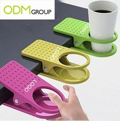 Google Image Result for http://theodmgroup.com/wp-content/uploads/2012/02/promotional-products-desktop-clip-cup-holders.jpg