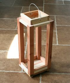 """how to make a rustic pottery barn lantern [1 bundle] redwood garden stakes [1"""" x 2"""" x 12""""]  $6.25 redwood board [2"""" x 2"""" x 8']  $2.77 thick gauge wire  $3.48 miter saw wood glue finishing nails clamps drill hammer or nail gun [if you're a bad ass] To start, you want to create the base of the lantern.  I grabbed 5 redwood stakes and cut off the pointy end to a length of 8.5″"""