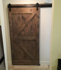 we just installed this british brace barn door with header in a small boston apartment to conceal a storage space sliding barn doors are a beautiful way to