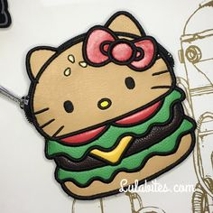 "Burger Coin Bag by Hello Kitty x Loungefly. Comes in faux leather material. Measures 5x5"". Sanrio licensed."