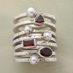 """SNOWFLOWER STACK RINGS--Hammered sterling silver bands alternate garnets with cultured freshwater pearls. Exclusive. Whole sizes 5 to 9. Set of 7, together approx. 3/8""""W."""