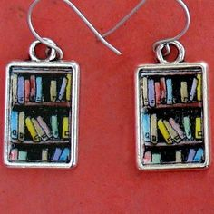 Bookshelf earrings for the bibliophile.  $15.95  -  Cute little drawings of books in a bookcase in silver toned frames make the perfect accessory for any avid reader.