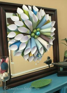 You know how it is when your browsing around on Pintrest and you come a crossed a craft you know have to make like right now! Well this paper cone wreath was just that project for me a few weeks a...