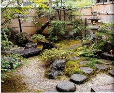 Perfect Japanese Garden In The Corner Of A Yard. Bamboo, Lantern, Stones.