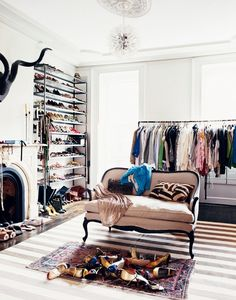 It's only sensible that the creative director and president of J.Crew have an extensive and glamorous wardrobe, and the dressing room in Jenna Lyons's Brooklyn brownstone, which was featured in the November 2008 issue, more than rises to the challenge. Her layered rugs are still on-trend today, and we admire her balance of rustic and glamorous pieces.