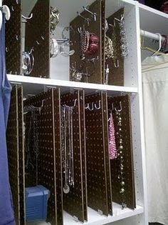this is genius and would work a treat to transport jewelry to craft fairs and such: sliding pegboard jewelry holder